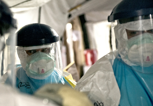 Photo: Men in biohazard suits
